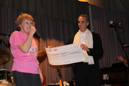 Kay presents the cheque